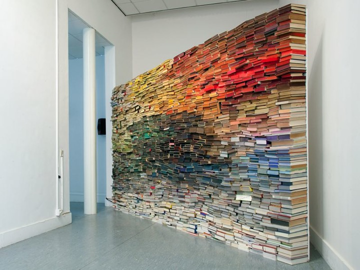Kriuthof likes to invent new things out of fragments of the past and is revitalizing the books by using them as objects (bricks). & The Wall of Books | iGNANT.com