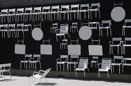 A wall painting with chairs