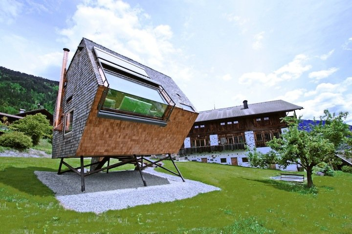 This Austrian house Ufogel is a fully-furnished and functional home set on  a hillside overlooking some of the best mountain views in the area.