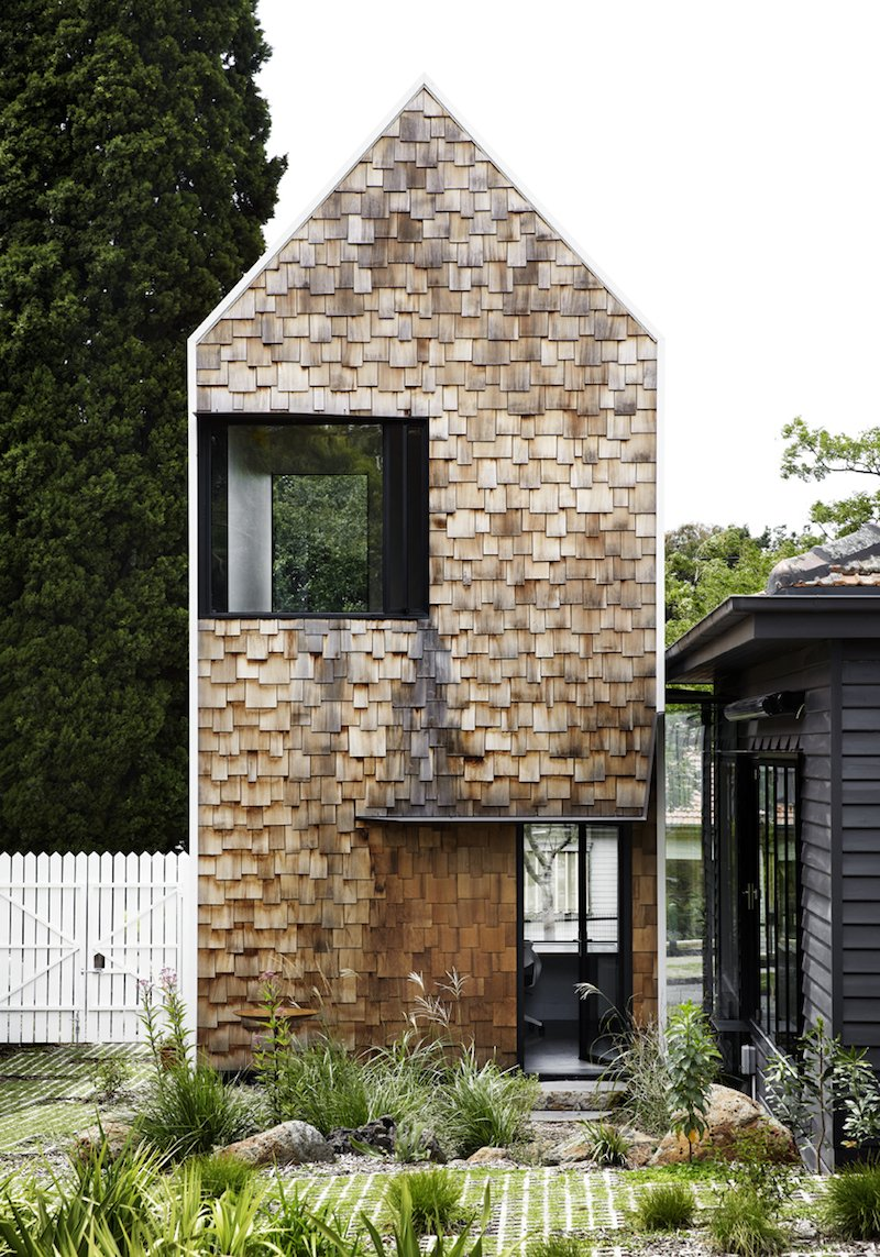Andrew maynard 39 s tower house is made up of seven small for Tower house plans