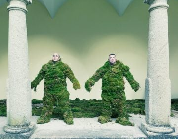 Two men dressed in moss. The Moss Men of Bejar.