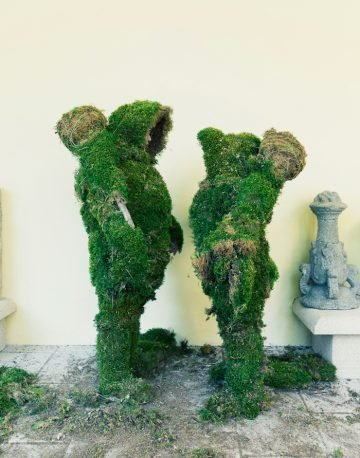 Two people facing each other dressed in moss.  The Moss Men of Bejar.
