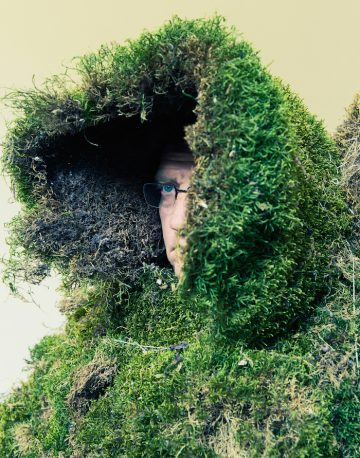Man under a hood of moss. The Moss Men of Bejar.