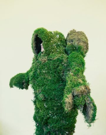 Woman dressed in a suit of moss. The Moss Men of Bejar.