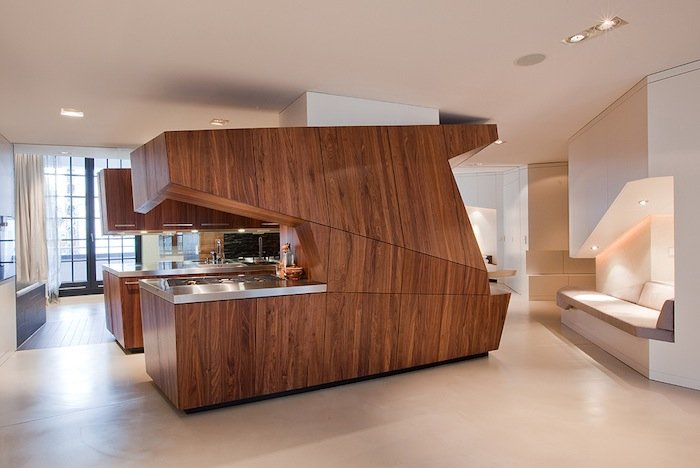 A compact freestanding kitchen and bath by graft lab for End of line kitchen units