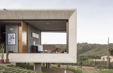 A Minimal Concrete House Offering Stunning Views From Both Sides