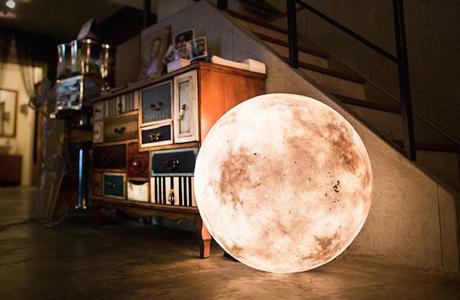 A Lamp That Looks Like A Full Moon By Acorn Studio