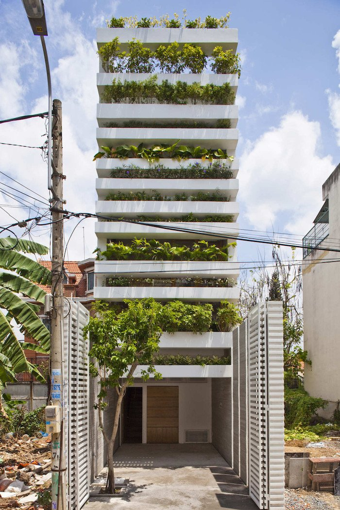 a concrete house with a vertical garden in vietnam | ignant