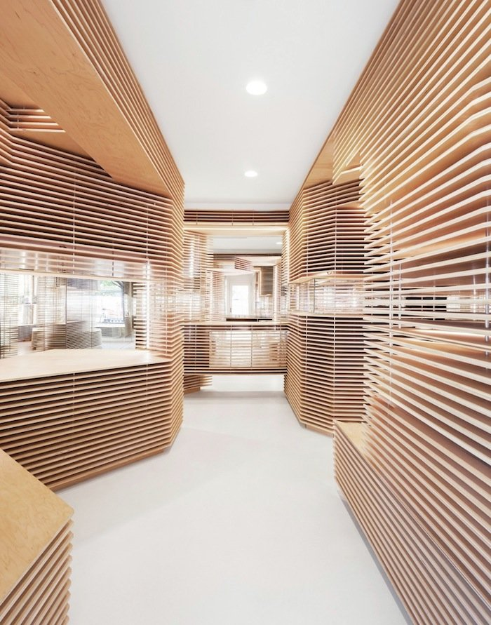 a store with wooden layered interiors by jordana maisie