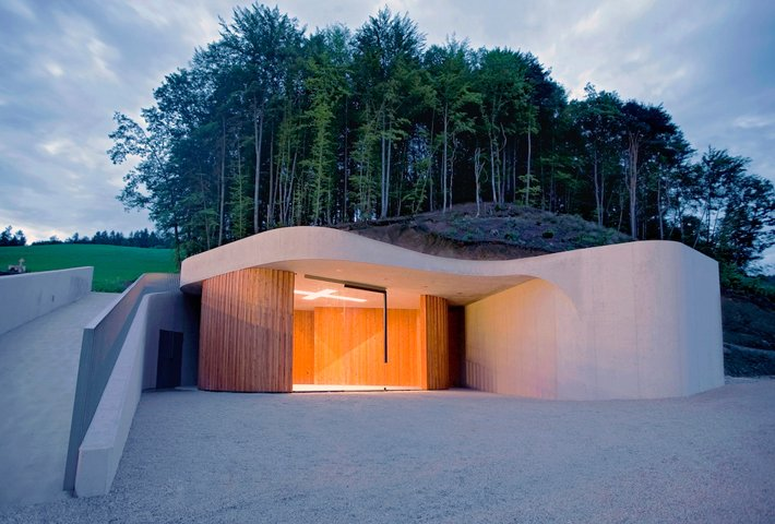 A Curved Concrete Chapel By OFIS Architects