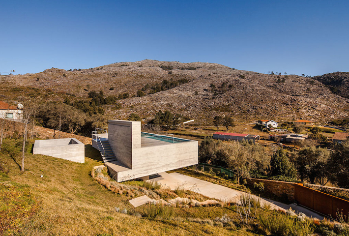 A Concrete House With A Rooftop Pool In Portugal
