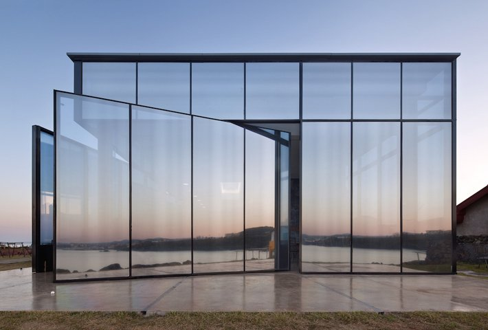 A Café With Pivoting Doors On A Volcanic Island