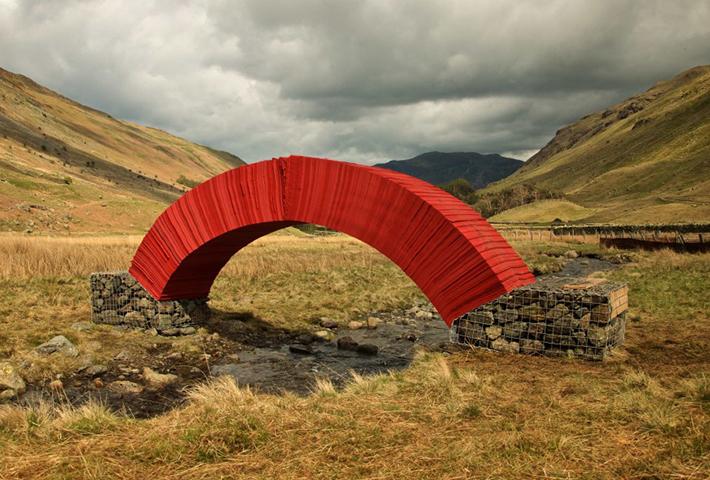 A Paper Bridge Crossing A Babbling Brook