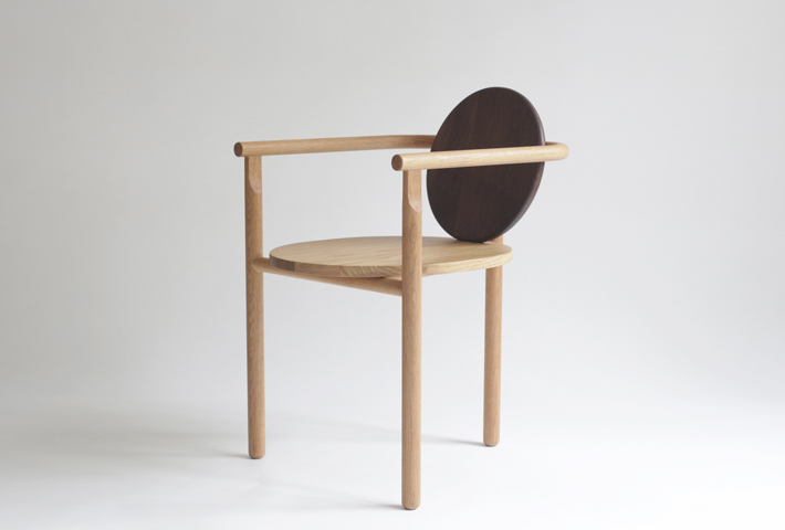 A Three-Legged Wooden Chair By Milk Design