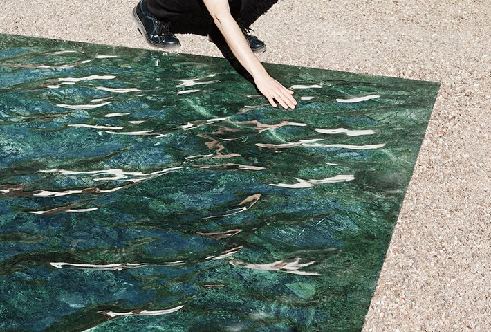 A Liquid Marble Installation That Captures Perpetual Motion