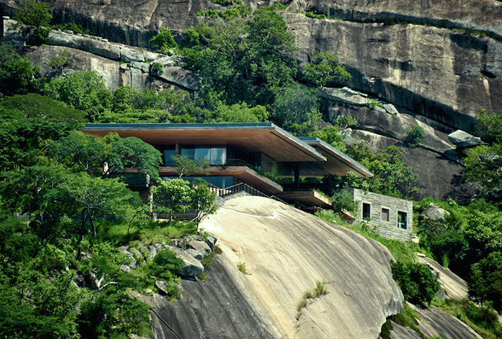 A House On A Rock Overlooking A Dam