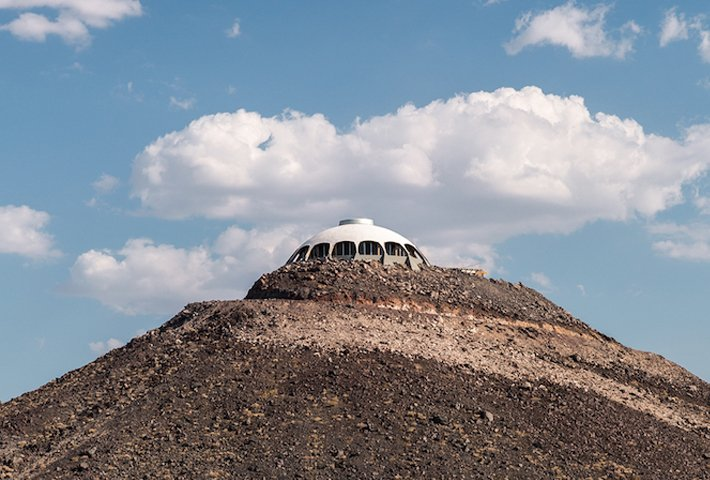 A Dome Shaped House In The Middle Of The Desert