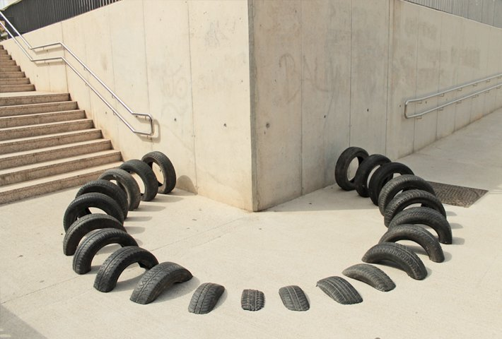 Tires Rooted In The Ground In Barcelona