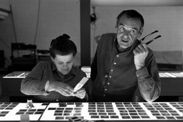 An Eames Celebration. Charles and Ray Eames selecting slides. ∏ Eames Office LLC