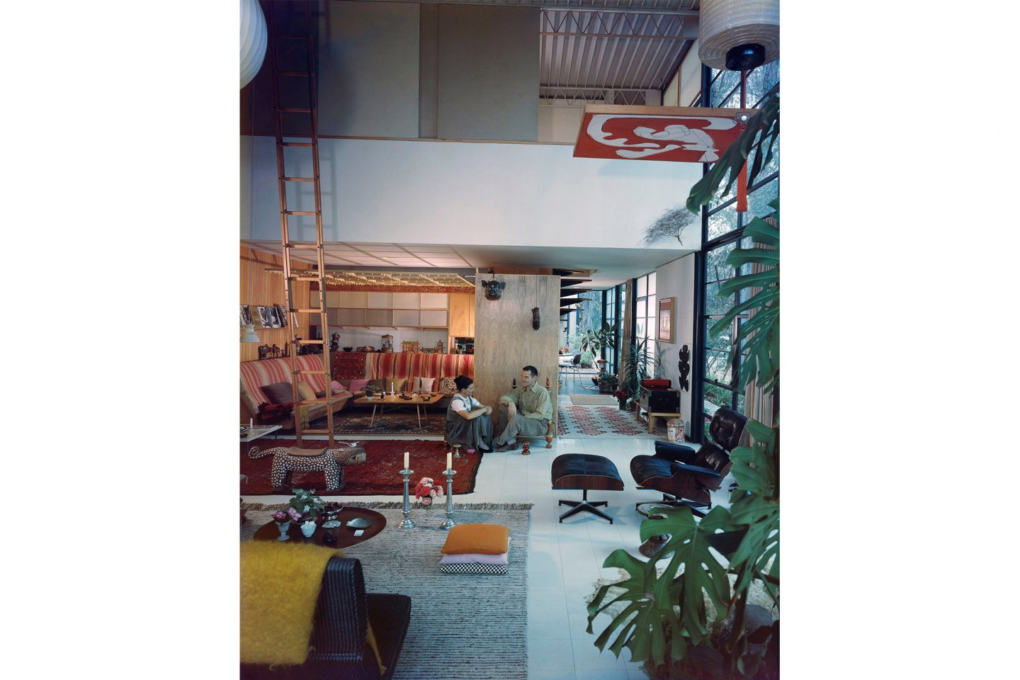An Eames Celebration. Charles and Ray in the living room of the Eames House, 1958