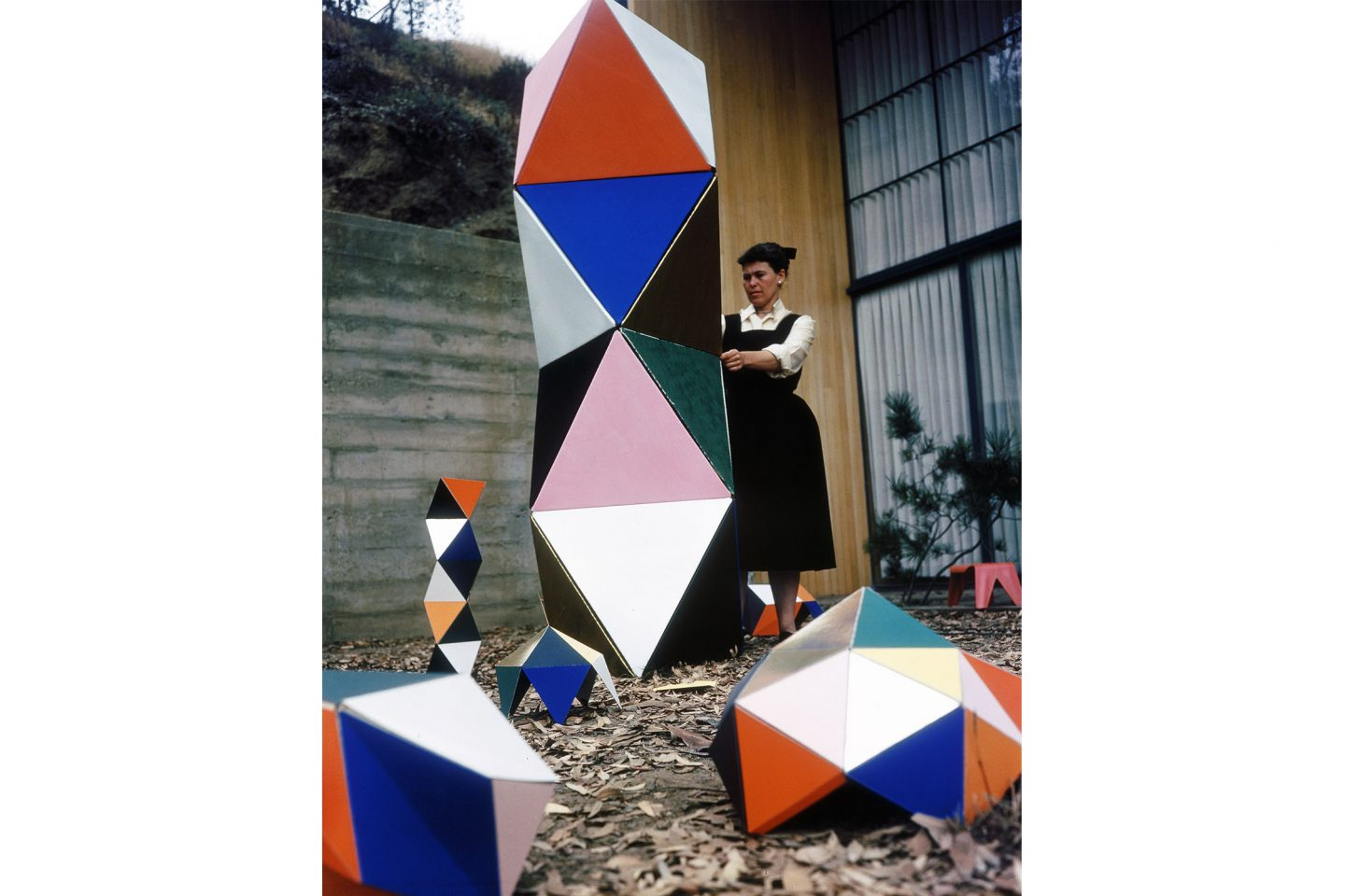 Ray Eames with an early prototype of The Toy in the patio of the Eames House, 1950. ∏ Eames Office LLC