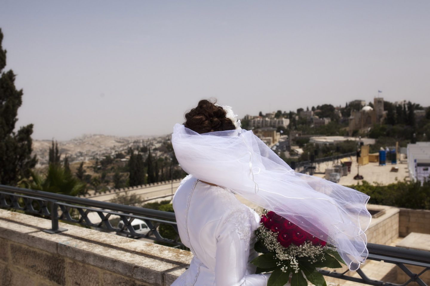 during a portrait session of a bride. In Jerusalem (Israel).