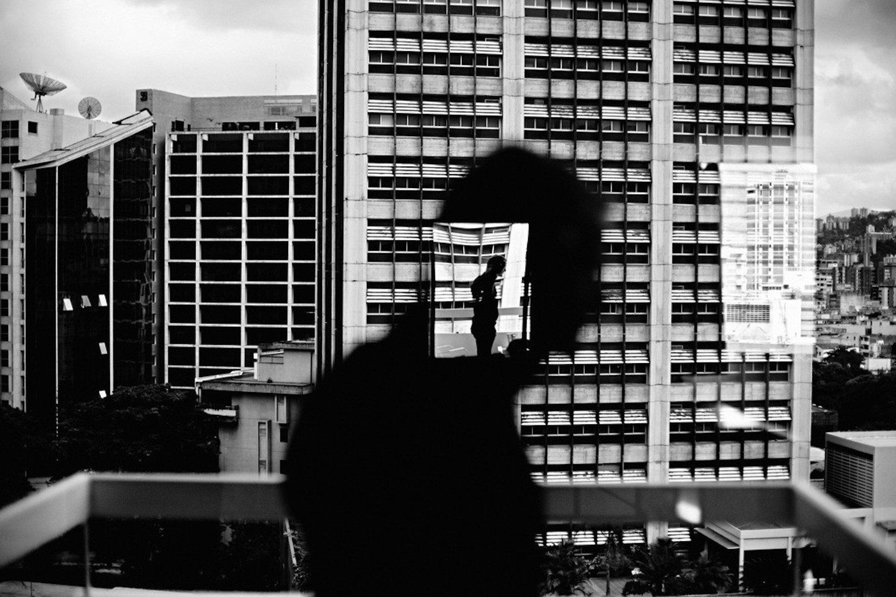VENEZUELA. Caracas. 2006. Reflection in window in Altamira.