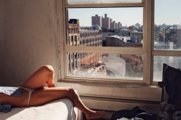 USA. Brooklyn, NY. 2009. Marion on bed.