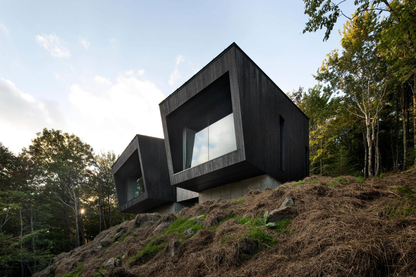 Naturehumaine Designs A Two-Part Cabin Built Of Burnt Wood In The Forests Of Quebec - IGNANT