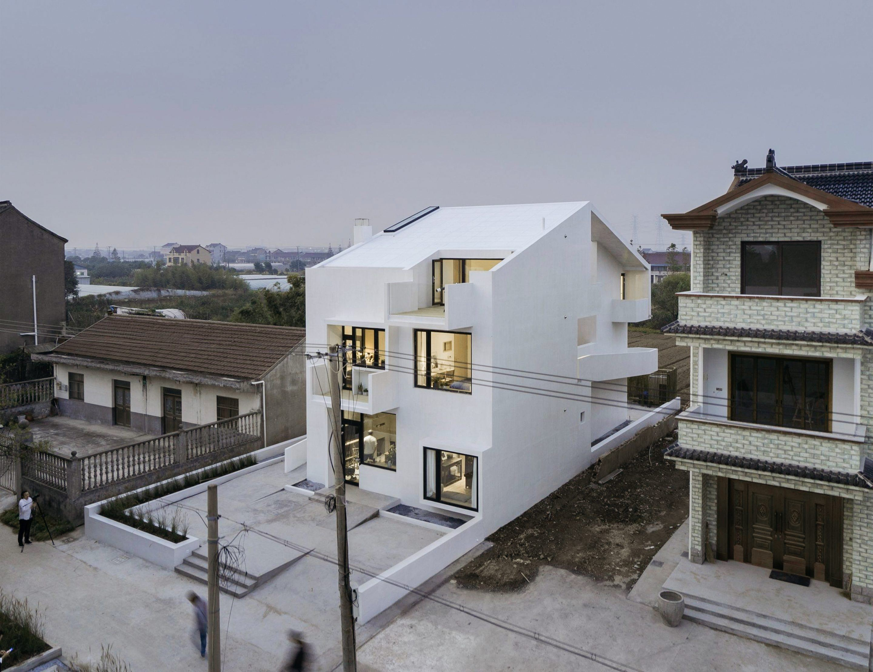A Winding Wheelchair Ramp Determines The Facade And Form Of