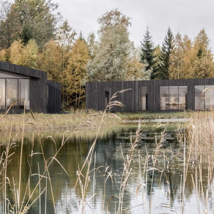 Cute little colorful private real sauna house by the private lake shore in autumn, yellow autumn tree leaves.