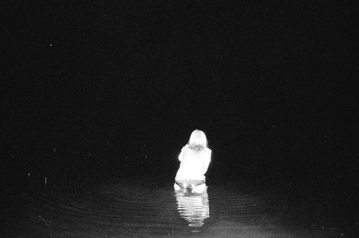 """""""a black and white photo of a woman standing in the sea from Lina Scheynius"""