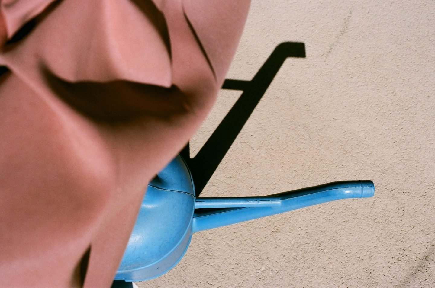 """alt=""""a colorful photo of a blue base of a terracotta umbrella from Lina Scheynius photo - essay for Tabayer Jewelry """""""