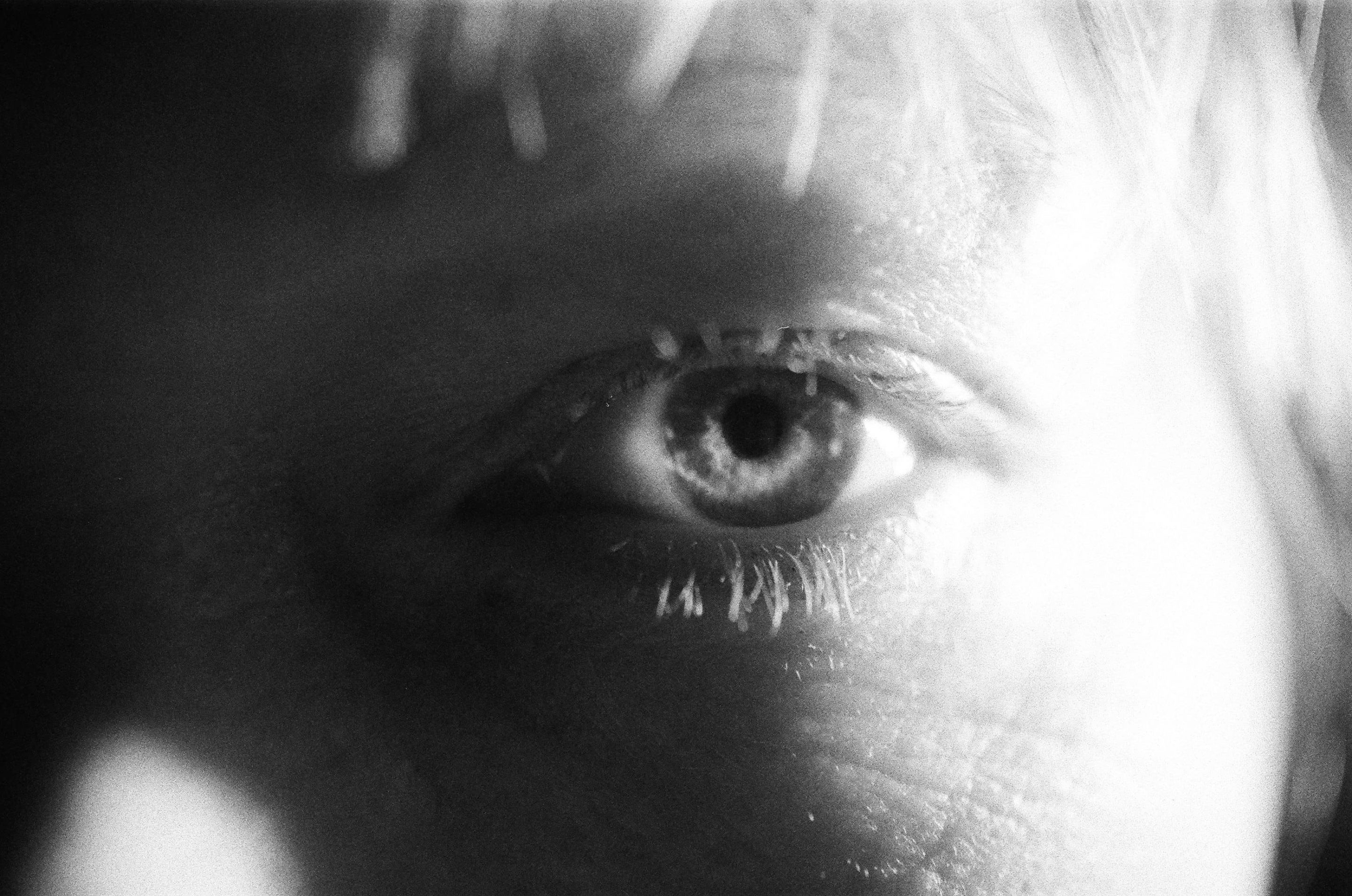 """alt=""""a black and white photo of a woman's eye from Lina Scheynius photo - essay for Tabayer Jewelry"""""""